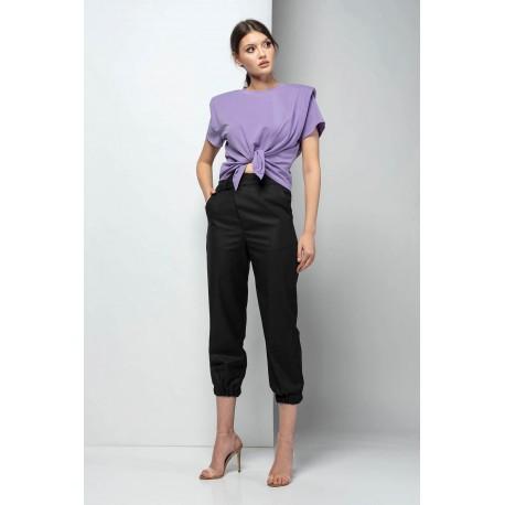 Pantaloni trei sferturi cu betelie asimetrică